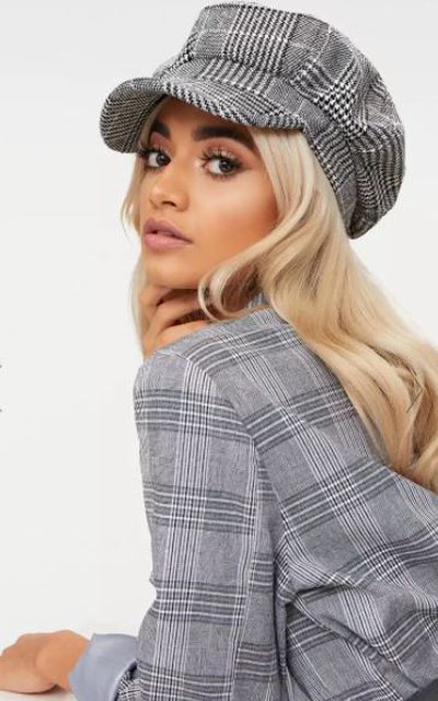 "Pretty Little Thing <a href=""https://www.prettylittlething.com.au/monochrome-checked-baker-boy-hat.html"" target=""_blank"">monochrome checked baker boy hat</a>, $22."