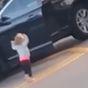Devastating moment toddler raises hands in air as parents arrested