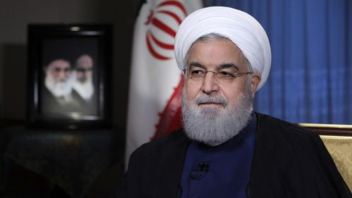 President Hassan Rouhani addresses the nation in a televised speech in Tehran, Iran. President Rouhani struck a hard line as the US restored some sanctions that had been lifted under the 2015 nuclear deal. (AAP)