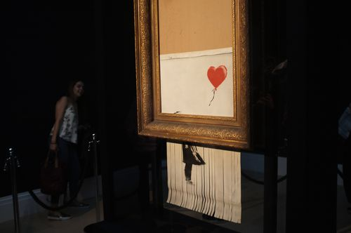 Banksy released a video this week suggesting his 'Girl With Balloon' artwork should have been completely destroyed in a planned stunt during the auction.