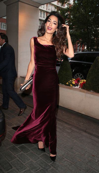<p>Human rights lawyer, Amal Clooney, may be right at home in the court room, but ever since she married actor George Clooney in Italy in 2014, she has more than found her footing in the fashion world.</p> <p>For an appearance at the WAAAUB Chapter Gala Dinner in London, the mother-of-two decided to brave the British summer heat in a floor-length custom-made velvet gown from Alberta Ferretti.</p> <p>The burgundy gown was complemented by a berry-coloured lip and drop diamond earrings, ensuring that Clooney took out top honours in the fashion stakes on the night.</p> <p>Velvet has swept back onto stylist's lists thanks to fashion's fascination with '90s trends, but this time around there are more glamorous options than plain crushed dresses.</p> <p>Sensual, rich and warm, velvet is the perfect material to turn to in the cooler months when lace and leather just won't cut it on a Saturday night.</p> <p>Take a look at some stylish ways to incorporate velvet into your wardrobe this Winter season.</p>
