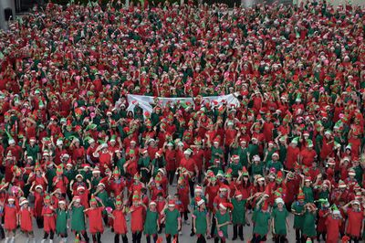 Thousands dressed as Santa's elves gather in a Bangkok mall to break a Guinness world record. (Nicolas Asfouri/AFP/Getty)