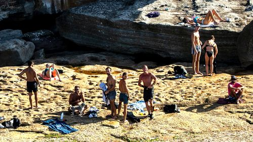 Groups of young people flout the social distancing guidelines at Bondi Beach, in Sydney.