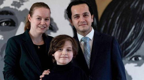 Belgian student Laurent Simons poses with his parents  Lydia and Alexander Simons during a photo session at his home on November 21, 2019 in Amsterdam.