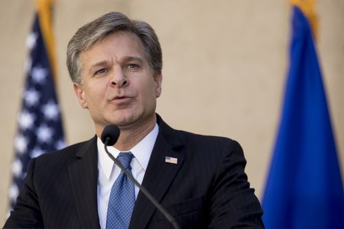 In this Sept. 28, 2017, file photo, FBI Director Chris Wray speaks at his installation ceremony at the FBI Building in Washington. Wray is dismissing Russia President Vladimir Putin's denial of election meddling. Wray said July 18, 2018, that he stands behind the U.S. intelligence agencies' assessment that Moscow did intervene. And he says Russia continues to use fake news and propaganda to stir up divisiveness in American society. (AP Photo/Andrew Harnik, File)