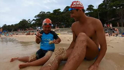 Eli-Luca and his dad Hamid at the beach.