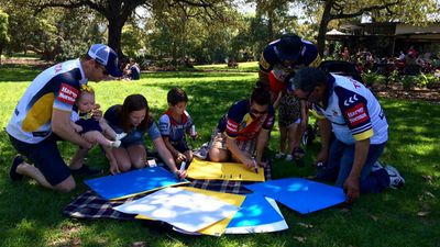 <p>Some Cowboys fans spent time making posters in Sydney. (9NEWS / Darren Curtis)</p>