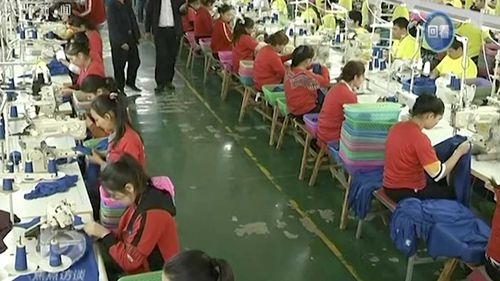 Muslim trainees work in a garment factory