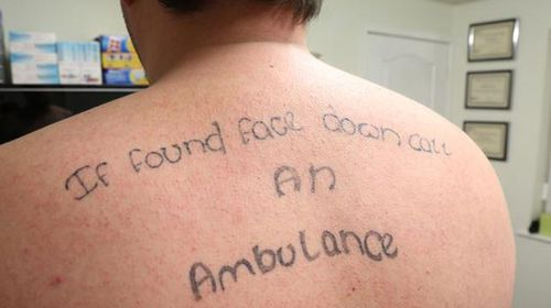 British man laughs off mate tattooing his back while passed out drunk
