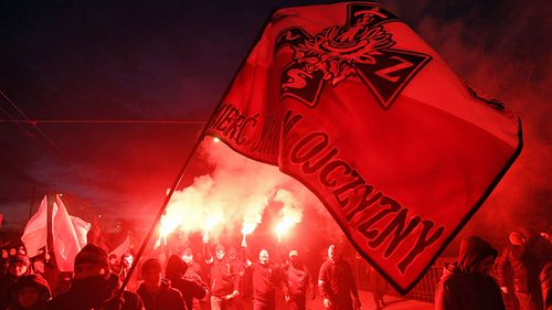 This far-right banner waved in Warsaw said: 'Death to the enemies of the homeland'. (Photo: AAP).