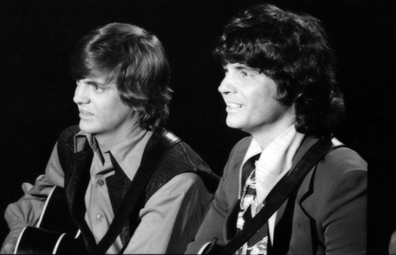 """Phil Everly and Don Everly of the rock and roll band """"The Everly Brothers"""" perform on a TV show in circa 1970 in London, England."""