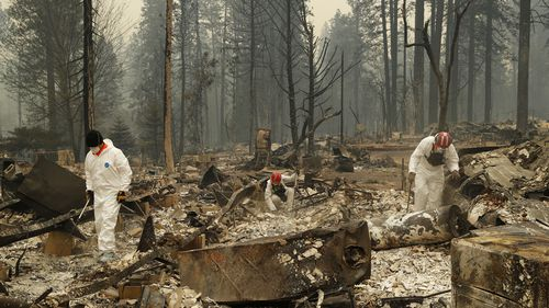 the death toll from the California wildfires has risen to at least 51 as authorities comb the blackened landscape looking for the remains of anyone who died in the disaster.