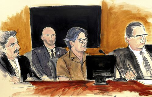 Keith Raniere, second from right, leader of the secretive group NXIVM, attends a court hearing in the Brooklyn borough of New York