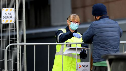 A security guard takes a delivery outside the Rydges Hotel which is being used as a quarantine hotel on July 10, 2020 in Auckland, New Zealand