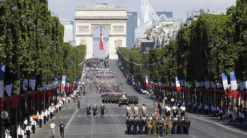 Troops march down the Champs Elysees during Paris' Bastille Day parade. (AAP)