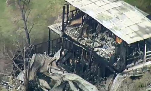 A father and son have been been found dead inside a home gutted by fire south of Geelong.