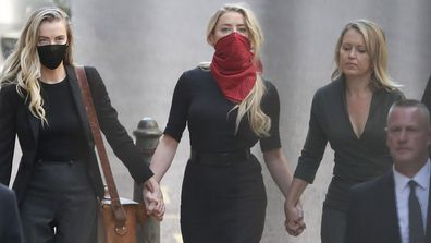 Actress Amber Heard, centre, arrives at the High Court in London, Tuesday, July 7, 2020