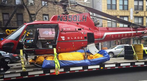The Liberty Helicopters aircraft that crashed into the East River has been salvaged for further investigation. (AAP)