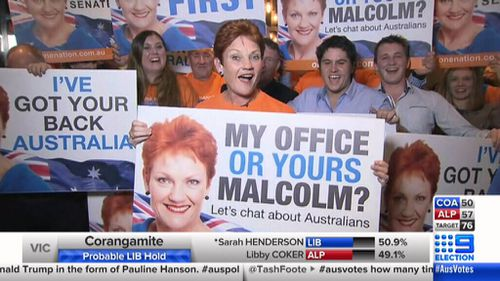 """Pauline Hanson with her """"My office or yours Malcolm"""" placard (9News)"""