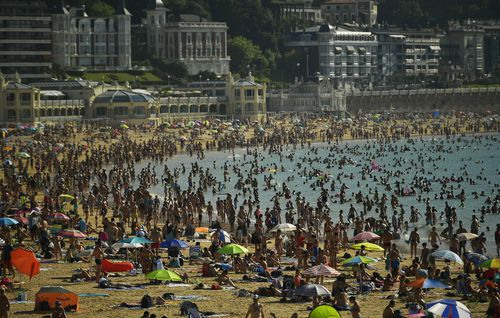 Thousands are flocking to Portugal's beaches to try and escape the heat. Image: AAP