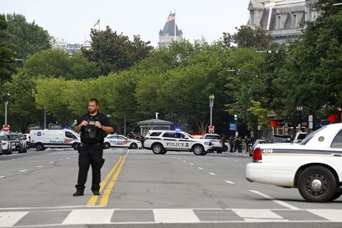 Law enforcement officials gather following a shooting that took place at 17th Street and Pennsylvania Avenue near the White House.