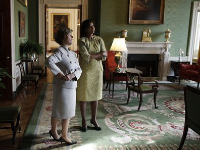 First Lady Laura Bush takes Michelle Obama for a private tour of the artwork in the East wing (Green room) of the White House