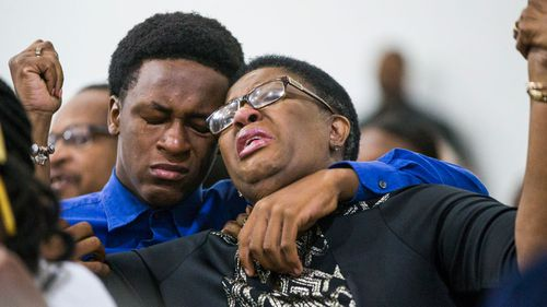 Brandt Jean, the brother of the fatally shot man, comforts his mother Allison Jean during a prayer service for her dead son.