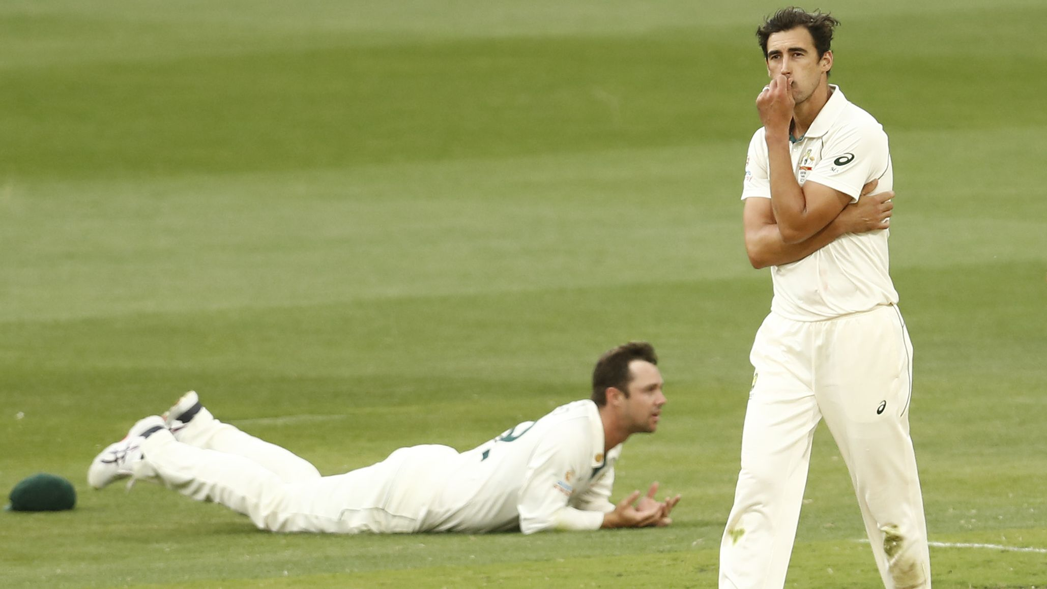 Mitchell Starc of Australia reacts after Travis Head drops a catch.