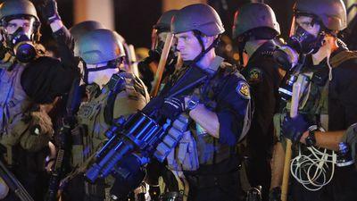 Police in Ferguson armed with tear grenade launchers. (Getty)