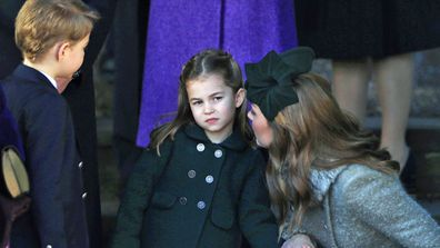 Catherine, Duchess of Cambridge speaks to Princess Charlotte as Prince George watches as they leave after attending the Christmas Day Church service at Church of St Mary Magdalene on the Sandringham estate on December 25, 2019 in King's Lynn, United Kingdom