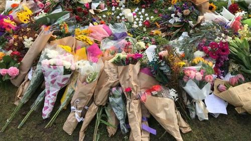 Floral tributes for just one of many women killed at random.