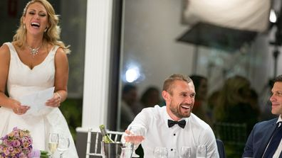 Clare and Jono share laughs at their Reception.