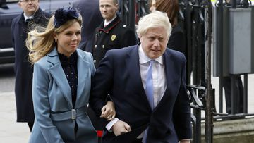 In this Monday, March 9, 2020, file photo Britain's Prime Minister Boris Johnson and his partner Carrie Symonds arrive to attend the annual Commonwealth Day service at Westminster Abbey in London.