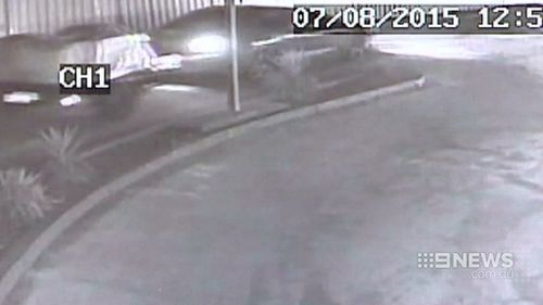 CCTV shows the robbers leaving the shop. (9NEWS)