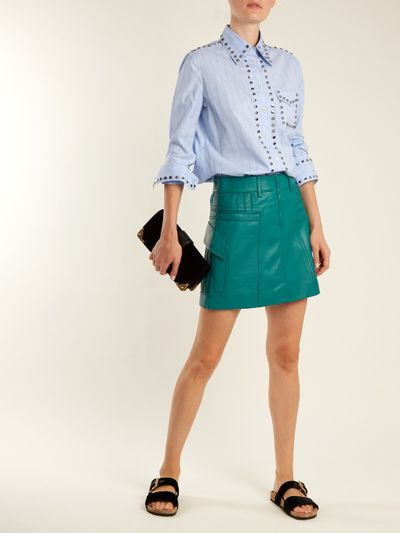 "Pin-tucked leather skirt, Prada at <a href=""https://www.matchesfashion.com/au/products/Prada-Pintucked-grained-leather-mini-skirt-1172903"" target=""_blank"">Matches Fashion</a>, approx. $1,745<br />"