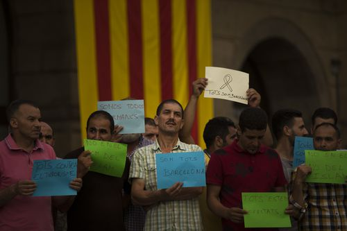 Members of the local Muslim community gather along with relatives of young men believed responsible for the attacks in Barcelona and Cambrils. (AP)