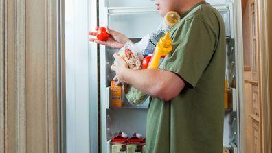 Teen at fridge
