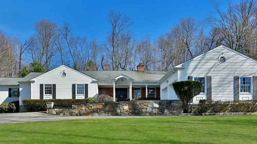 The Chappaqua house the Clintons bought next door to their own.