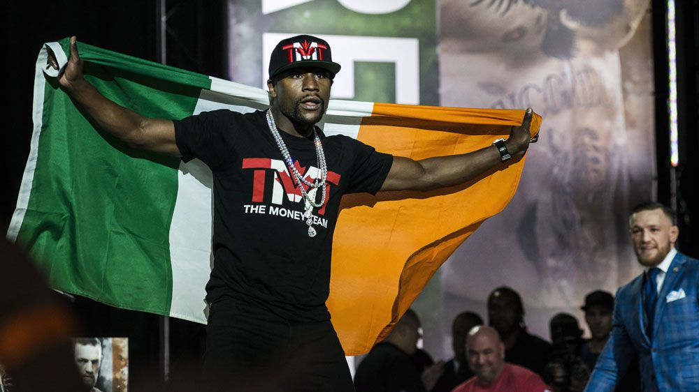 Insults fly in Toronto during McGregor, Mayweather press conference