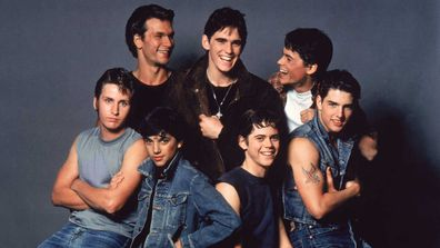 Patrick Swayze, Matt Dillon, Rob Lowe, Emilio Estevez, Ralph Macchio, Thomas C. Howell, and Tom Cruise on the set of The Outsiders.