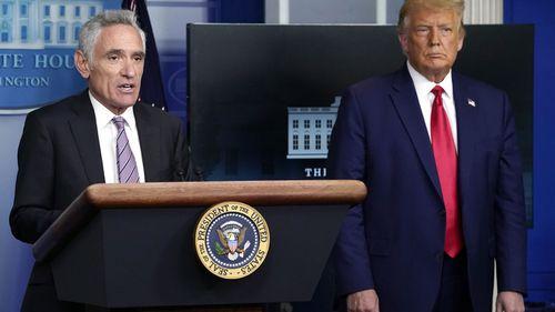 White House coronavirus adviser Dr Scott Atlas speaks as President Donald Trump listens during a news conference at the White House.