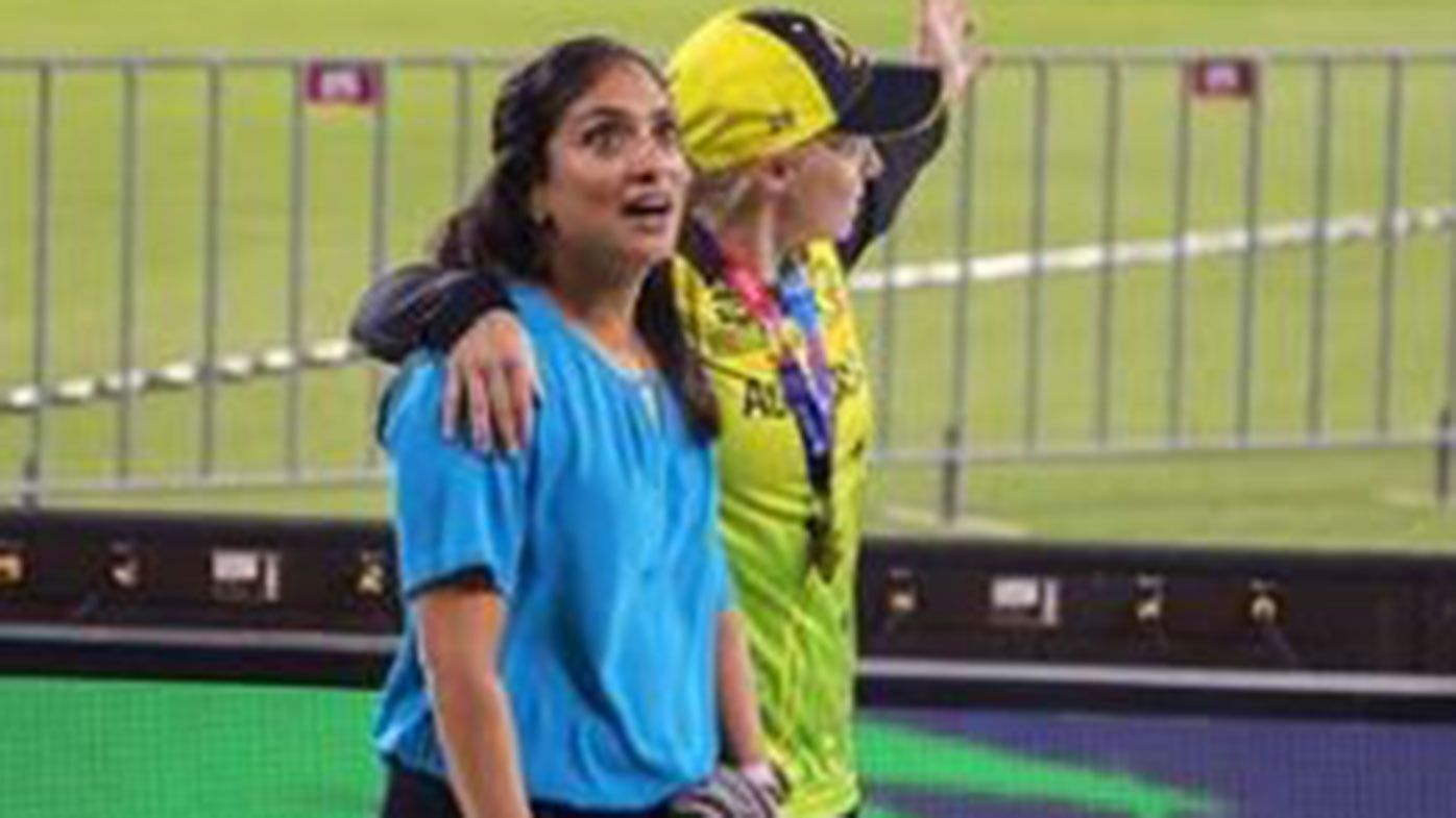 Former player Lisa Sthalekar with Alyssa Healy after Australia's T20 World Cup win.