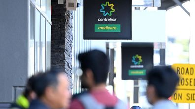 Lines at a Centrelink office.