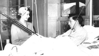 Then-Princess Elizabeth visits a tuberculosis patient at the Red Cross hut in 1951.