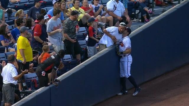 Tender moment as baseball player 'kisses' fan