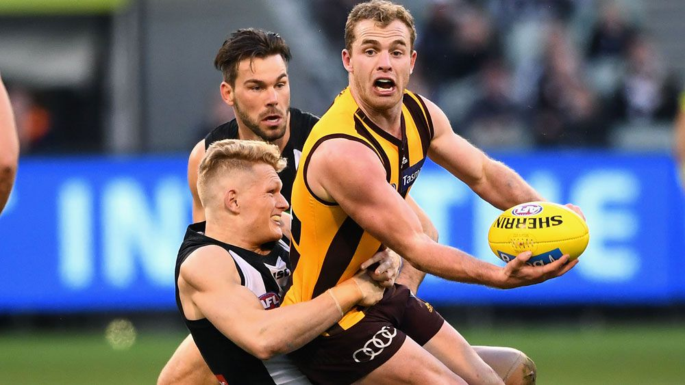 Mitchell stars as Hawks down Pies in AFL