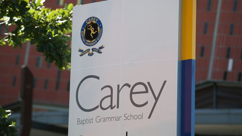 Carey Baptist Grammar has been shut down after an adult member of the school community developed symptoms consistent with COVID-19.