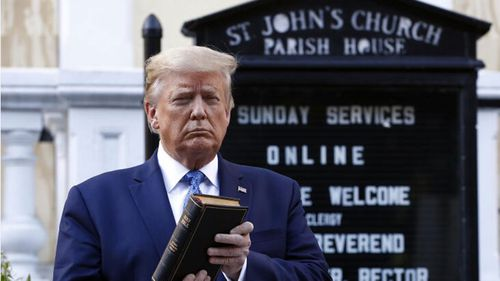Donald Trump holds a Bible as he visits St John's Church across Lafayette Park from the White House.