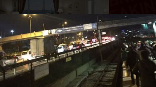 Passengers line the tracks after a blast on Istanbul's metro system.