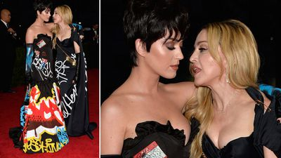 Pop princess Katy Perry and Queen of pop Madonna stood together, dressed in matching Moschino gowns with a graffiti design. (AAP)